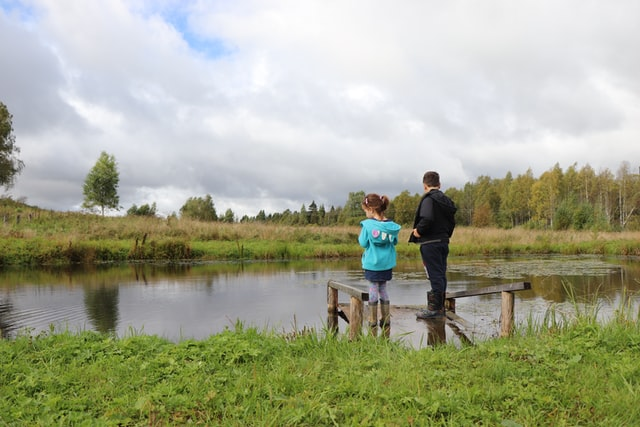 father & daughter fishing pond