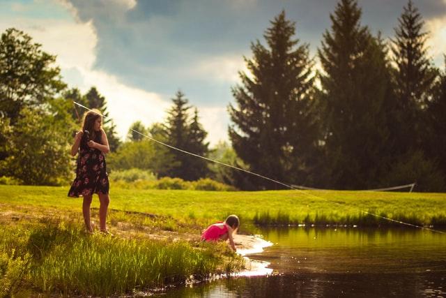 girl fishing pond