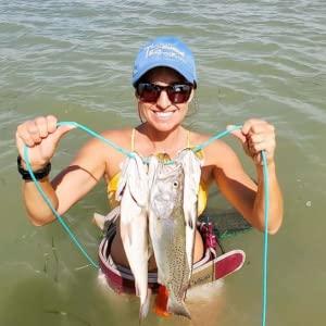 woman holding fish stringer